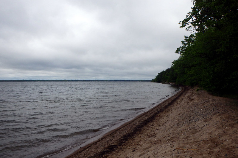 lake on the left, beach on the right, cloudy and windy
