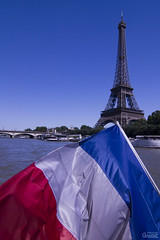 The French flag with the national colours blue, white, and red in front of the Eiffel Tower. Photo: Marc Caraveo (flickr) Creative Commons Licence Attribution + NoDerivatives
