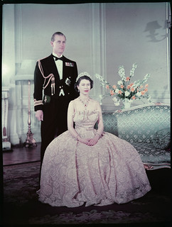 Queen Elizabeth the second seated in front of Prince Philip, Duke of Edinburgh / La reine Elizabeth II assise devant le prince Philip, duc d'Édimbourg | by BiblioArchives / LibraryArchives