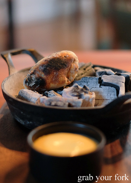 Potato damper cooked over charcoal at Restaurant Orana, Adelaide