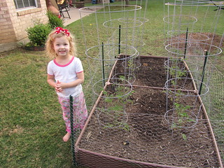 "Not to be outdone by a five-year-old in California, Claire requested to pose by ""her"" tomatoes as well. 