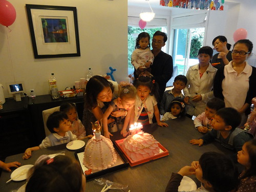 Birthday Party Blowing Out Cake