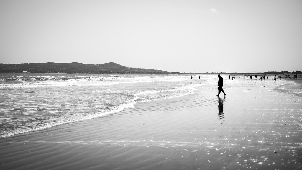 At the beach portmarnock ireland black and white street photography by giuseppe