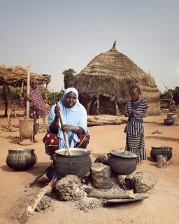 Hadiza prepares a family meal | by World Bank Photo Collection