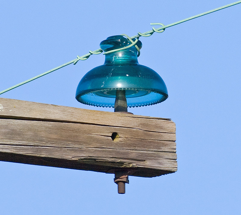 Glass insulators in the wild up in the air flickr for Glass power line insulators