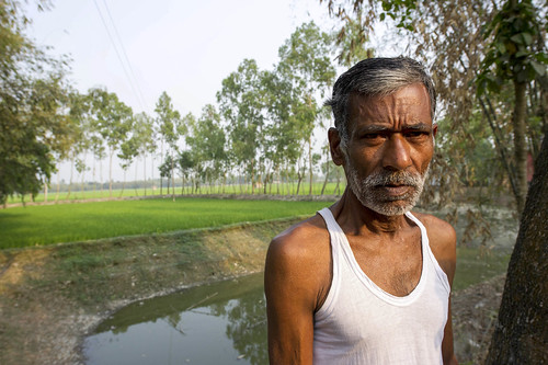 Man with his aquaculture pond and rice field, Bangladesh. Photo by Finn Thilsted, 2012 | by WorldFish