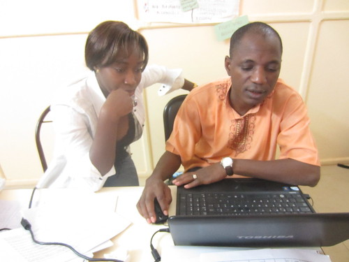 Mahamoudou Sawadogo and Bidimbouja Sodjinamanou working on the V5 operational comms plan | by Water and Food