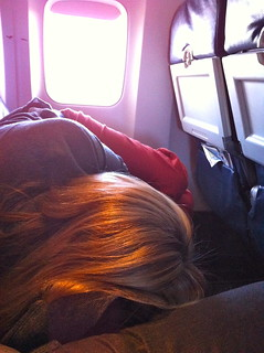 Heather sleeping on the flight to San Juan | by Dave Delaney