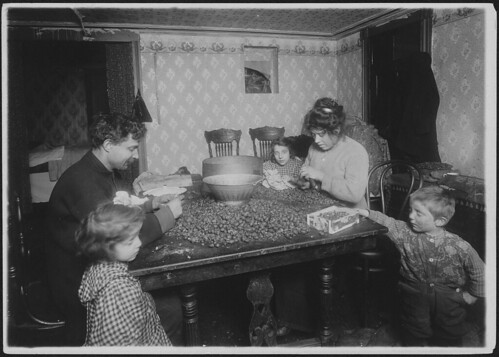 Picking nuts in dirty basement, December 1911 | by The U.S. National Archives