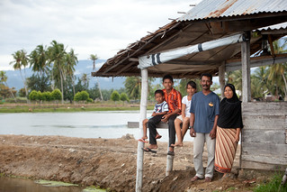 Shrimp farmer Rusli and his family, Aceh, Indonesia. Photo by Mike Lusmore/Duckrabbit, 2012. | by WorldFish