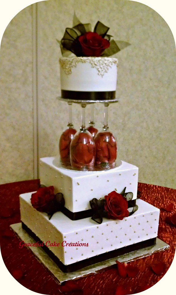 Elegant Ivory Wedding Cake with Gold, Black and Red accent… | Flickr