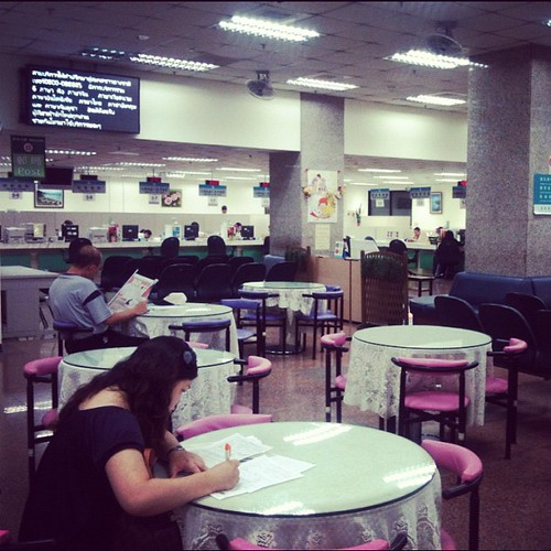 The Taiwan immigration agency is so fancy - people can fill out forms on tables with glass tops, lace tablecloths, and padded pink chairs. Taipei, Taiwan | by Tricia Wang 王圣捷