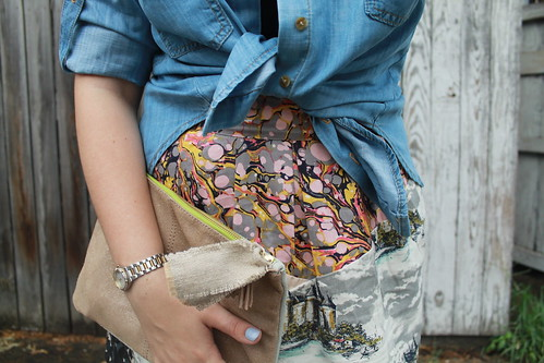 "Chambray and mixed prints outfit: ""Washed chambray buttondown"" from Anthropologie, Dolce Vital sandals, Mixed-print skirt from Anthropologie, sparkly suede clutch, black camisole, Bauble Bar monogram necklace,etc. 
