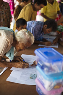 Elderly people sign up for health packages | by World Bank Photo Collection