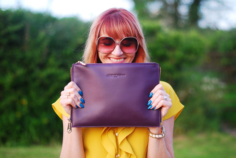 Summer brights: Ruffled yellow blouse, Jennifer Hamley Model KT Workbag clutch, oversized 70s sunglasses | Not Dressed As Lamb