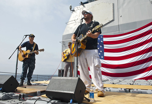 CO of USS Cape St. George performs with country music singer Toby Keith during a USO performance. | by Official U.S. Navy Imagery
