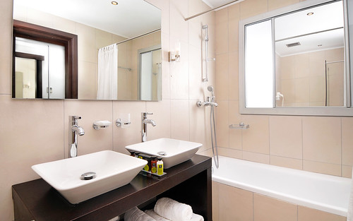 The Kassandra Bay Hotel Interconnecting Family Room bathroom | by KB Collection Hotels & Resorts