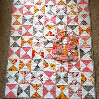 FMF Flea Market Fancy Hourglass baby quilt. Used tutorial by cluck cluck sew and baby bib is from One Yard Wonders | by Sew It Pretty