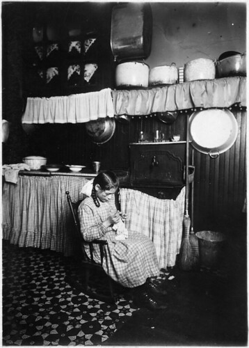Camela, 12 years old, making Irish lace for collars. Works until 9 P.M. in dirty kitchen, January 1912 | by The U.S. National Archives