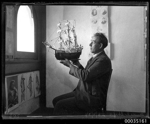 Man holding up a model of 16th century ship, 23 June 1934 | by Australian National Maritime Museum on The Commons