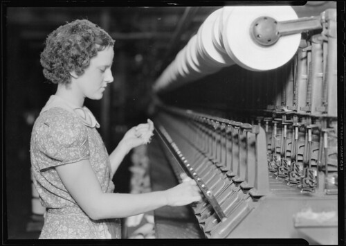 Woman pulling thread, 1936 | by The U.S. National Archives