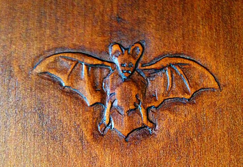 Carved bat this a by charles greene