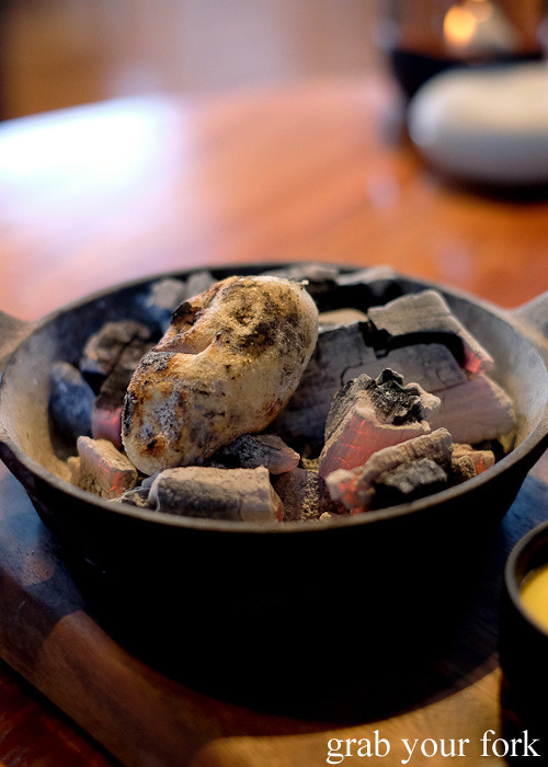 Cook your own potato damper on charcoal at Restaurant Orana, Adelaide