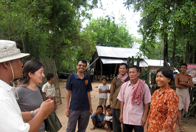 WorldFish and CARE, Cambodia staff discussing with small-scale fish farmers in a village in Cambodia. Photo by Jharendu Pant, 2009.