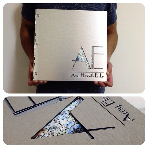 custom graphic design portfolio book on brushed silver aluminum with