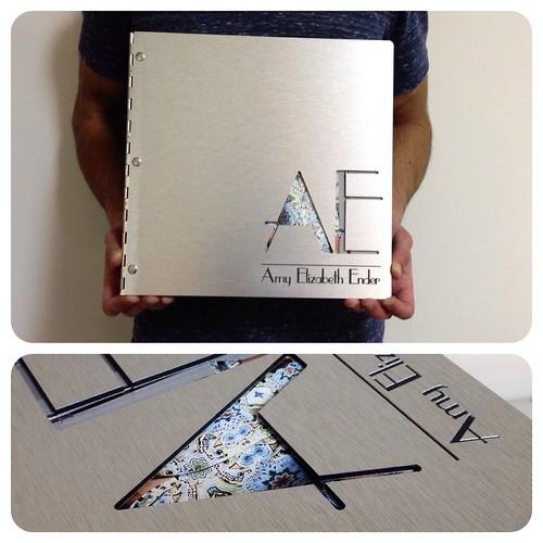 custom graphic design portfolio book on brushed silver alu