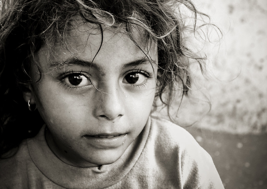 Black and white portrait of a yemeni little girl with big dark eyes yemen