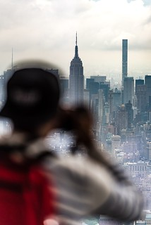Visitor taking photographs of Empire State Building and the Manhattan skyline at One World Observatory in One World Trade Center. | by javansg