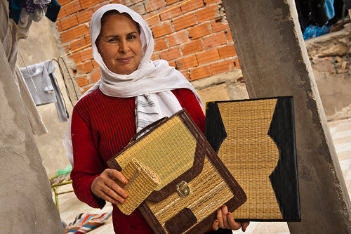 Zina, trained in handicraft work makes items from palm tree by-products including furniture | by World Bank Photo Collection