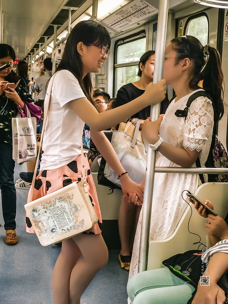 two girls holding hands in shanghai subway, candid shot, i… | flickr
