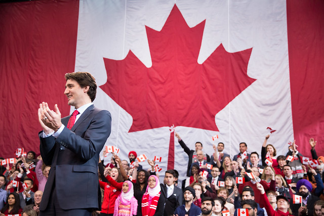 Justin and PM Jean Chrétien celebrate the Canadian flag's 50th anniversary in Mississauga. February 15, 2015.