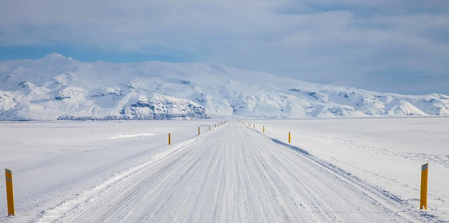 Iceland Ring Road after a winter storm, view to Vatnojokull Glacier massif