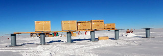 Cargo winterized on 6-foot high spools to minimize drifting at the drill site | by U.S. Ice Drilling