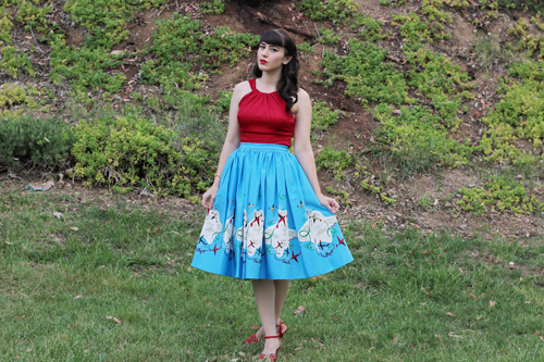 Pinup Girl Clothing Pinup Couture Jenny Skirt in Mary Blair Planes Border Print Harley Top in Red
