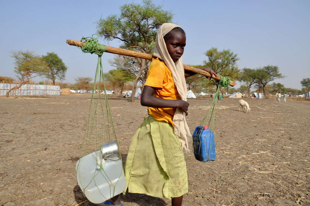 Image result for girls collecting water
