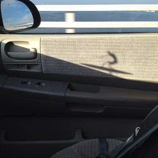 When driving home from work, my dashboard surfer made a cool shadow. @rootssurfcraft  #shadows #thesundoessomecoolshit #DashboardSurfer | by Heritage Surf Shop