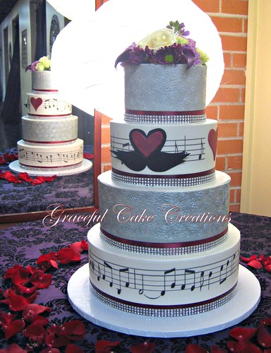 Elegant Silver And White Wedding Cake With Music Notes And
