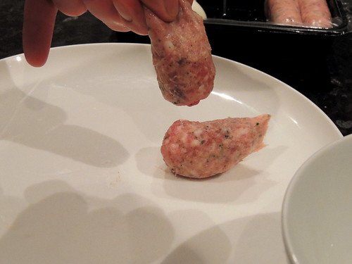 Scotch eggs - squeezing out sausage meat | by rosemarybeetle