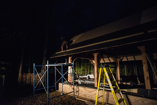 Tyler Affixing Tar Paper to Cottage Roof at Night | by goingslowly
