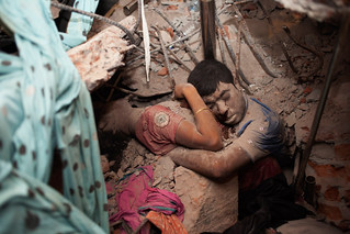 April 25, 2013. Two victims amid the rubble of a garment factory building collapse in Savar, near Dhaka, Bangladesh.  Read more: http://lightbox.time.com/2013/05/08/a-final-embrace-the-most-haunting-photograph-from-bangladesh | by Asitimes