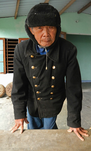 an old farmer at a Hoi An herb garden