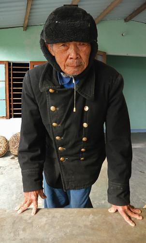 an old farmer at a Hoi An herb garden