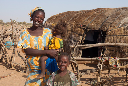 Mother and children outside of thatched hut in Northern Senegal. | by IFPRI