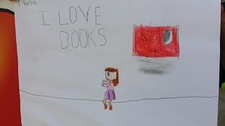 """""""I love books"""", mensaxe e debuxo de Noelia, unha visitante da caseta das bibliotecas"""