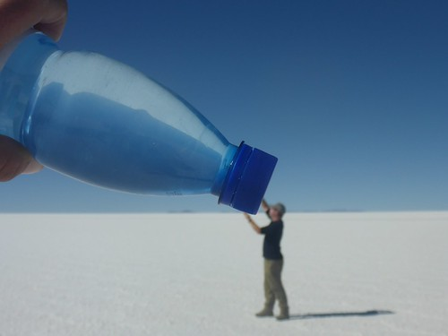 James drinking from a giant water bottle