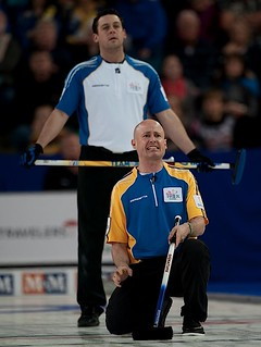 Kamloops B.C.Mar9_2014.Tim Hortons Brier.Alberta skip Kevin Koe,B.C.lead Rick Sawatsky.CCA/michael burns photo | by seasonofchampions